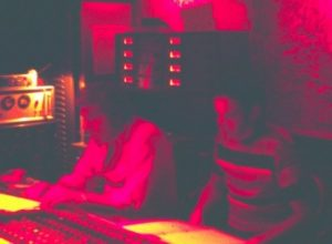 Picture of Stan Ross and Ernie Bringas at the recording console in Gold Star Studios